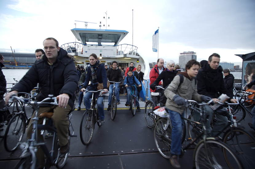 Cyclists leaving the IJ-ferry at Amsterdam Central Station during rush hour