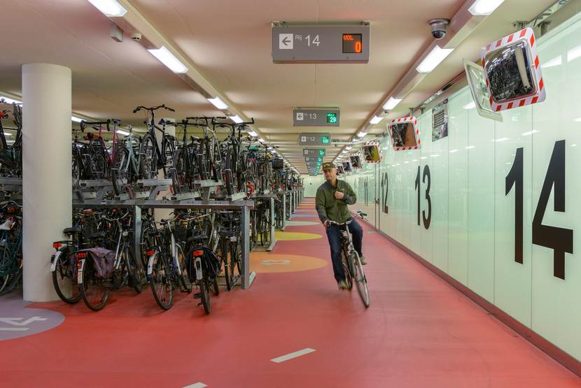 Cyclist in the bicycle garage at Rotterdam Central Station